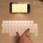 The iPhone 5 with Futuristic Laser Keyboard and Hologram Display